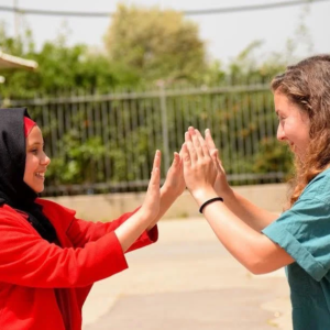 Two girls clapping hands